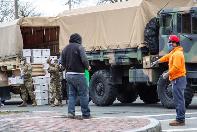 National Guardsmen unloading food