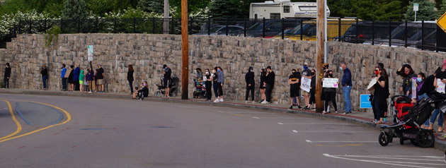 Lined up along the wall under the parking lot