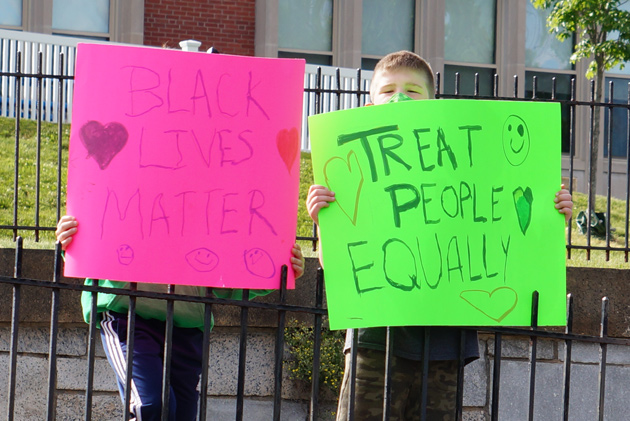 Treat People Equally sign